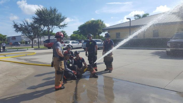 6 FireFighters Spraying Fire Hose