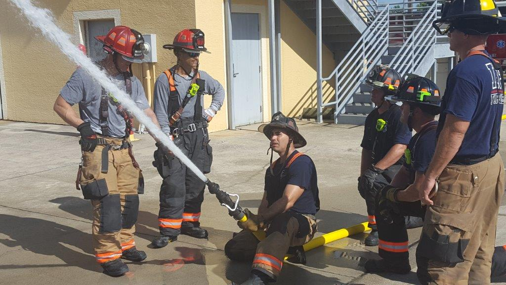 Firefighters Spraying Hose at Iona McGregor Fire District