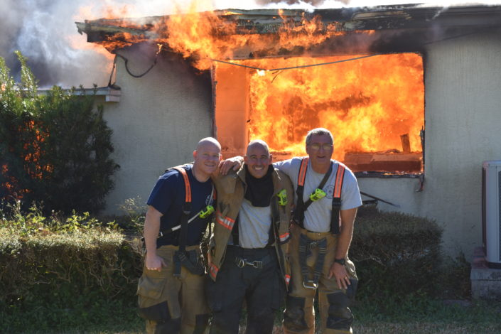 3 FireFighters fighting a Fire