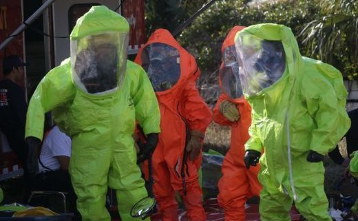 Firefighters in Haz Mat Suits during multi agency drill