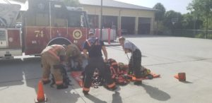 firefighters using wipes to clean themselves